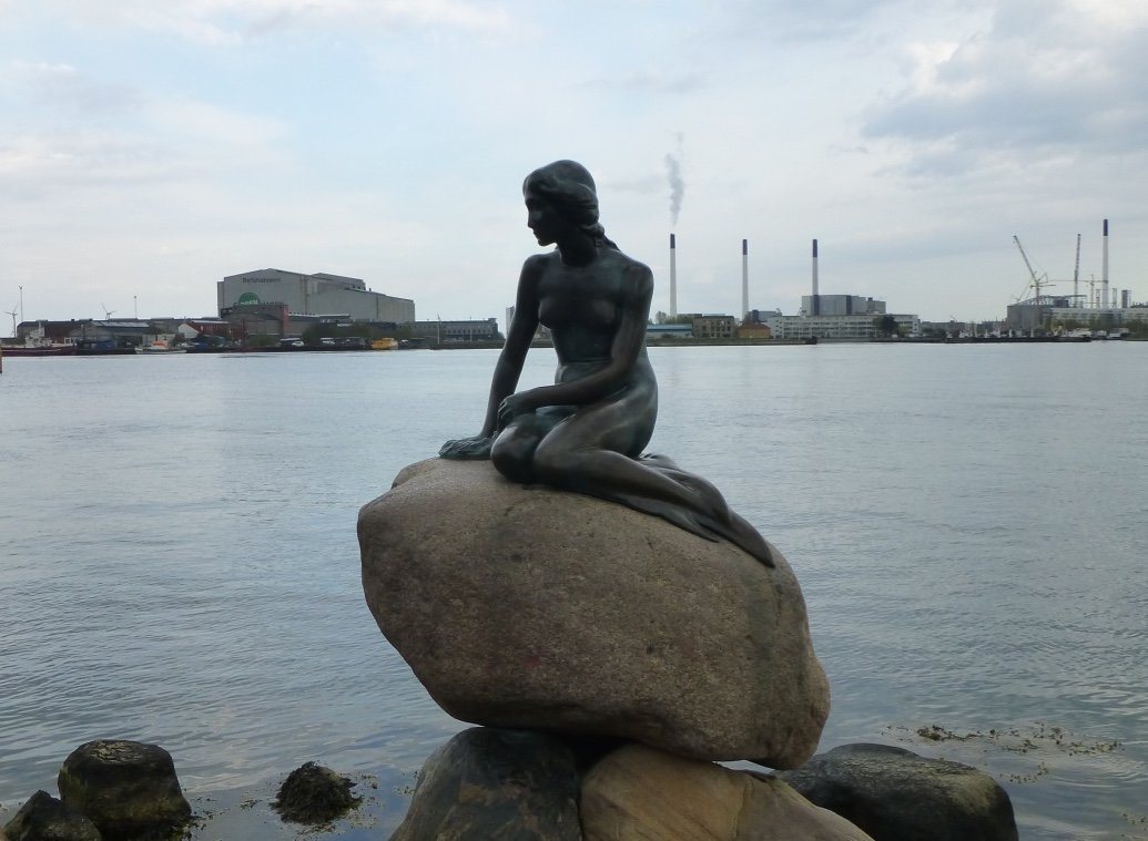 Cycling past the Little Mermaid in Copenhagen Denmark