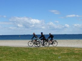 Cycling by the beach in Denmark